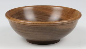 Walnut bowl with beaded rim. Turned by Paul Hannaby creative woodturning