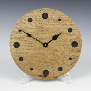 Black oak wall clock. Turned by Paul Hannaby creative woodturning