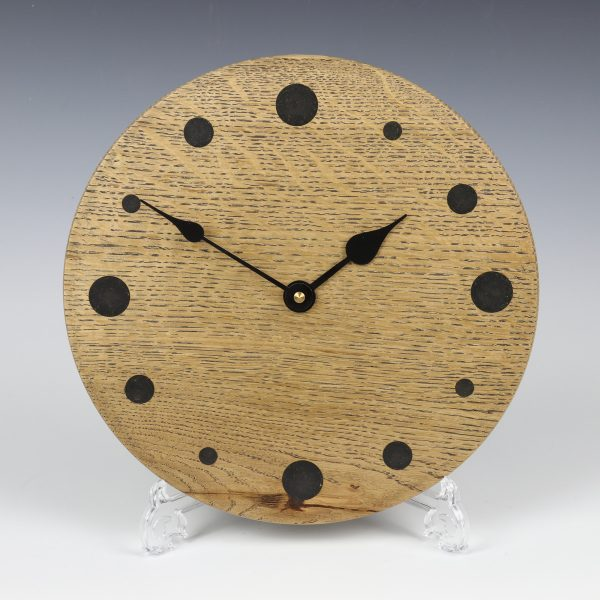 Black oak wall clock. Turned by Paul Hannaby creative woodturning